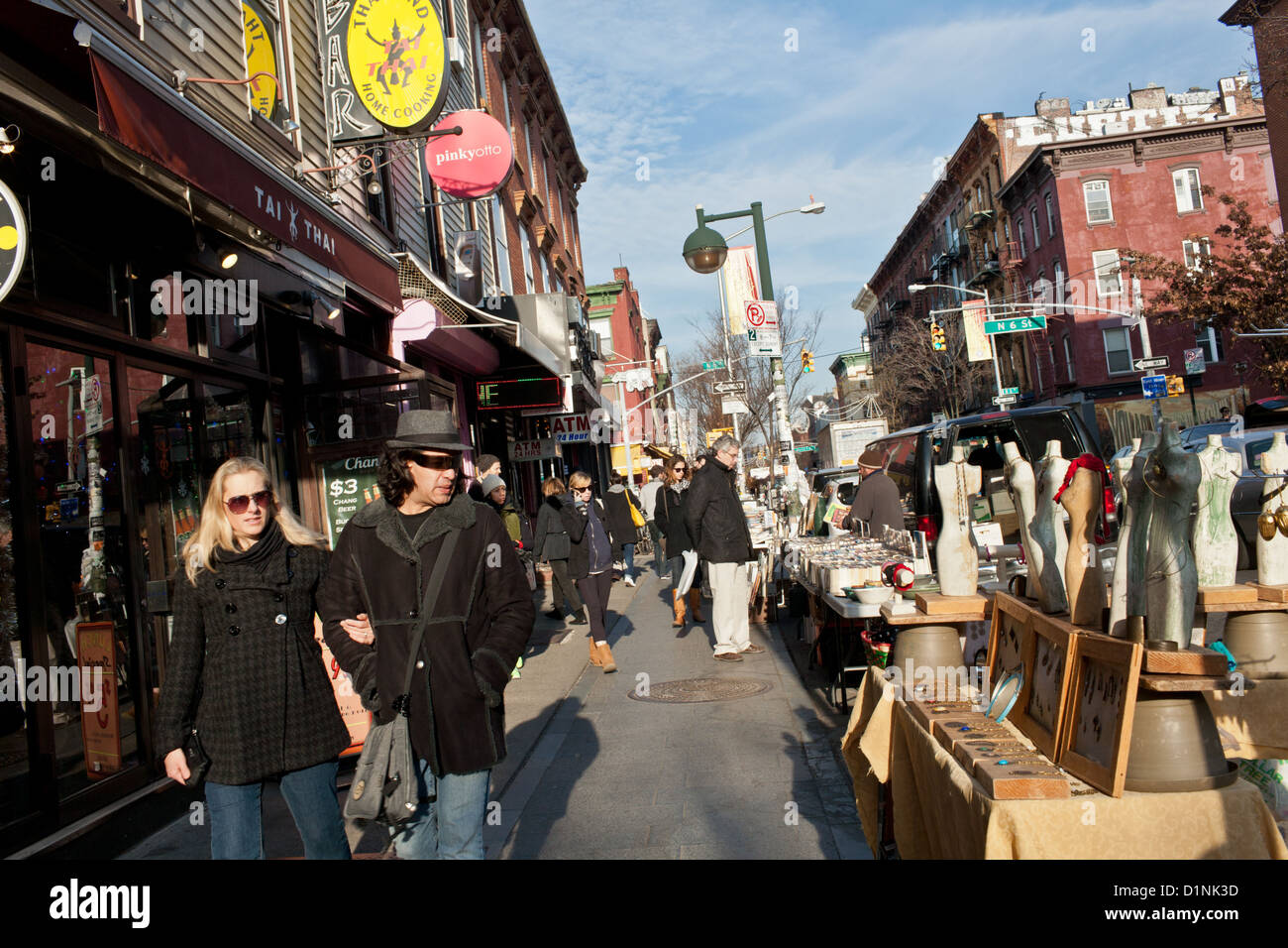 Sidewalk Sales Along Bedford Avenue Williamsburg Brooklyn New York . Full resolution  pic, nominally Width 1300 Height 956 pixels, pic with #BFAF0C.