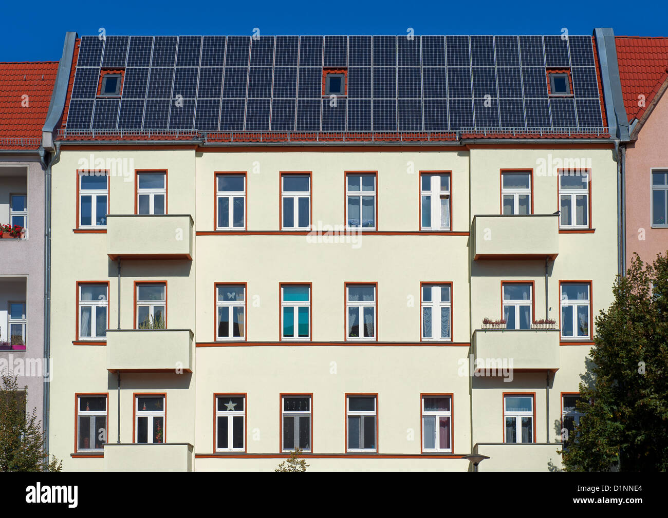 Apartment Building Roof apartment buildings with solar panels stock photo, royalty free