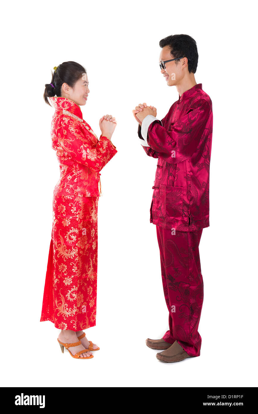 asian couple celebrating chinese new year in traditional clothes and stock photo royalty free. Black Bedroom Furniture Sets. Home Design Ideas