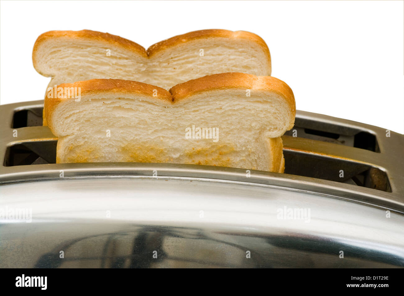 Toast In Toaster ~ Two slices of toast in an electric toaster stock photo