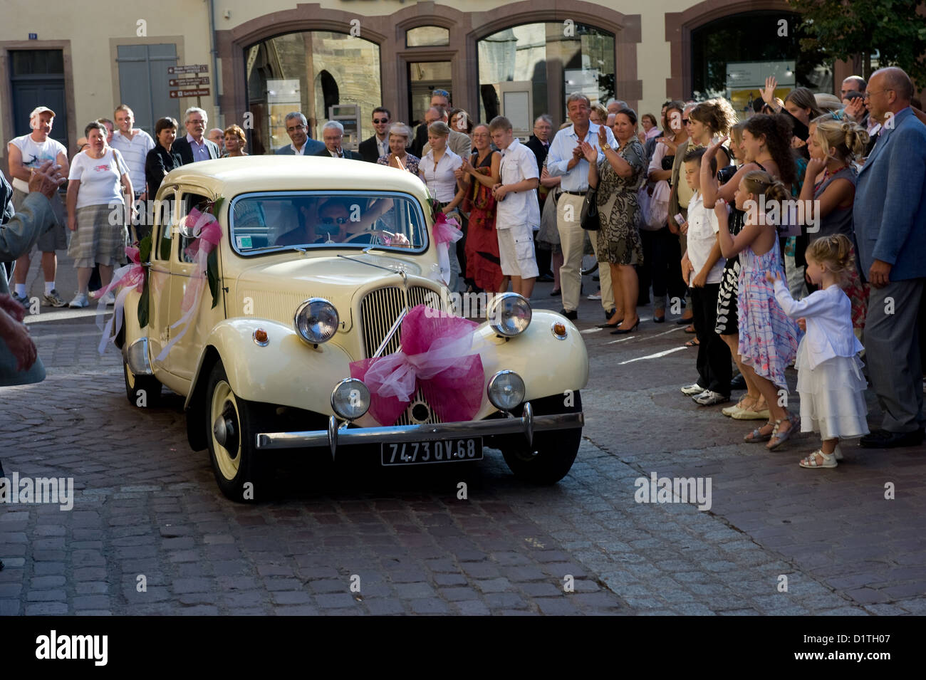 Colmar, France, a newly married couple rides with the wedding car in ...