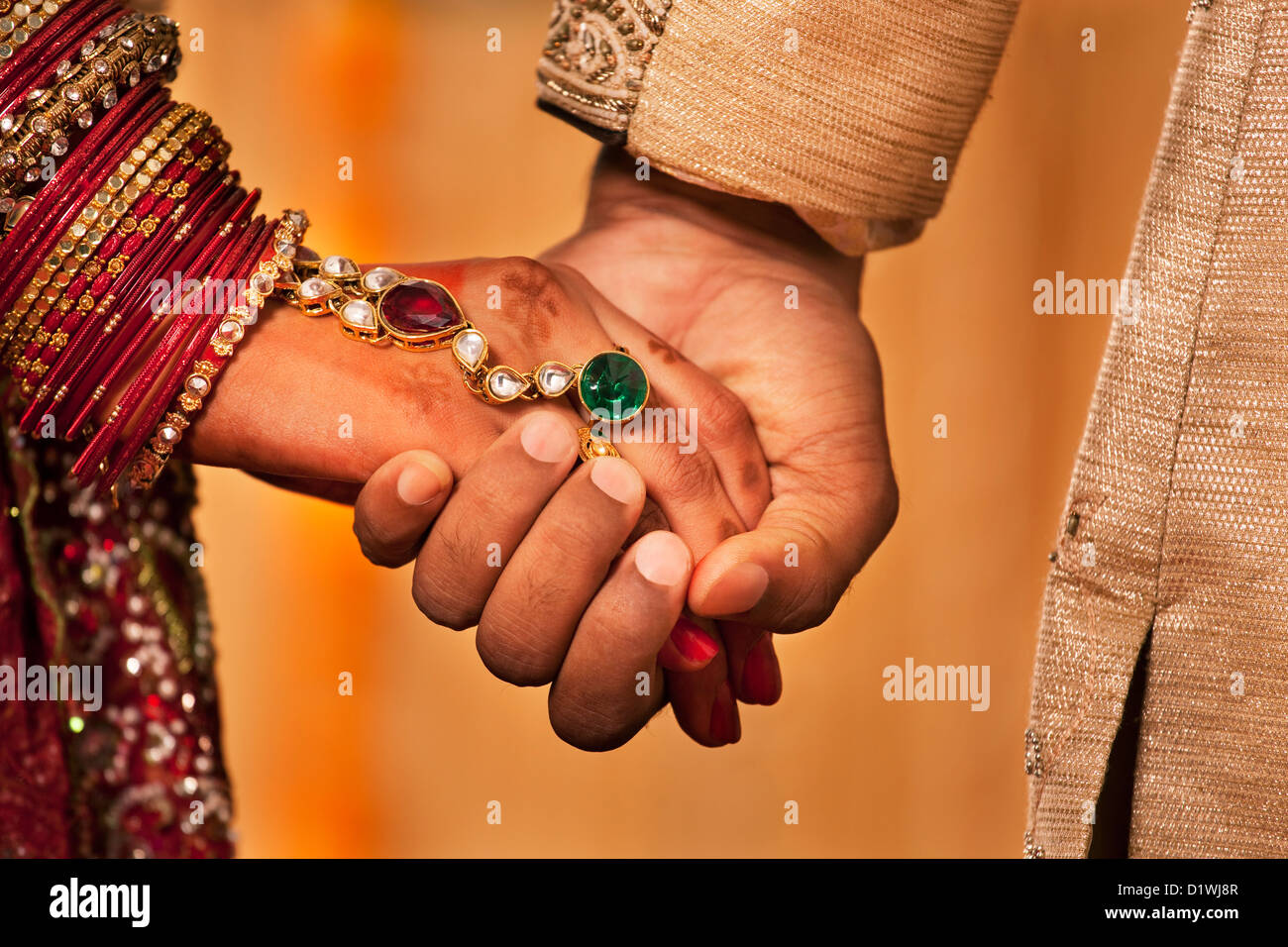 Indian Marriage Couple Hands Stock Photos & Indian Marriage Couple ...
