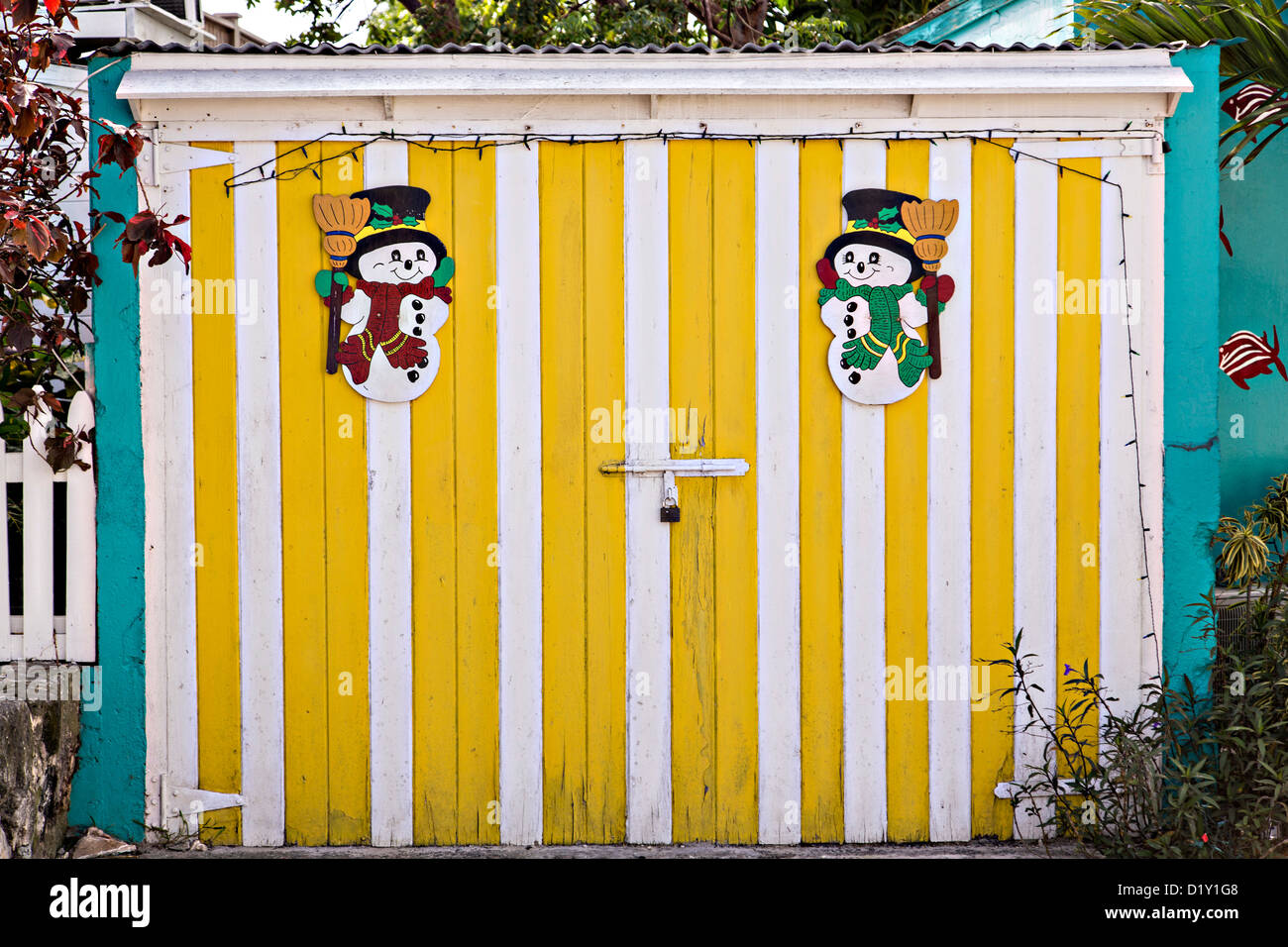 Christmas decorations on a colorful wall in Dunmore Town, Harbour ...
