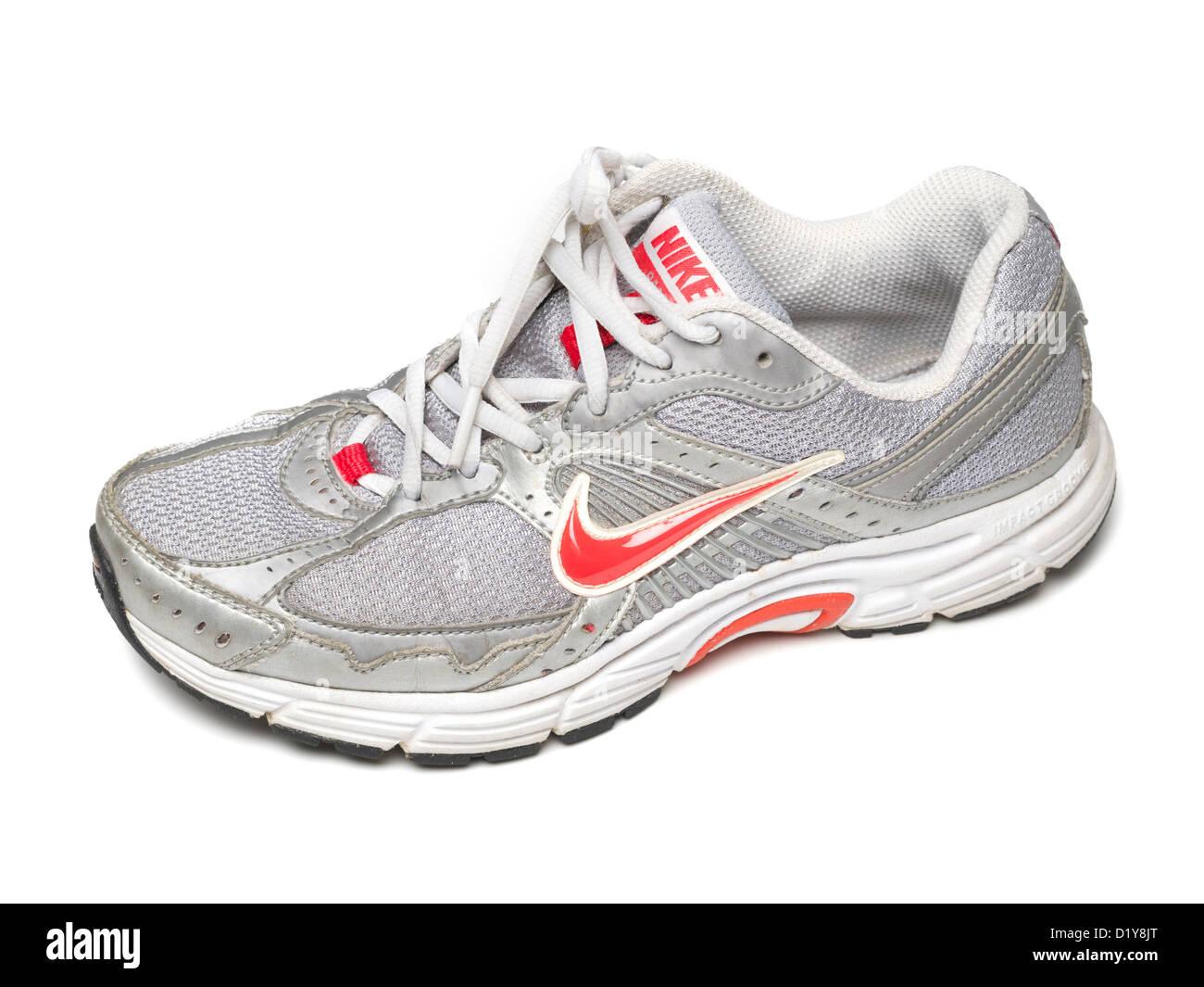 Grey Nike running shoe isolated on white background