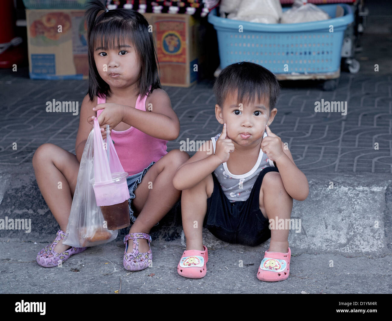 thai child Stock Photo - Thai children: 3 year sister and 2 year old brother. Thailand  S. E. Asia