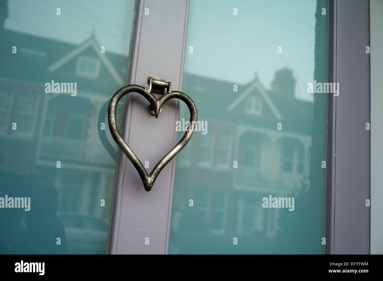 Heart shaped door knocker glass door reflections & Heart shaped door knocker glass door reflections Stock Photo ... pezcame.com