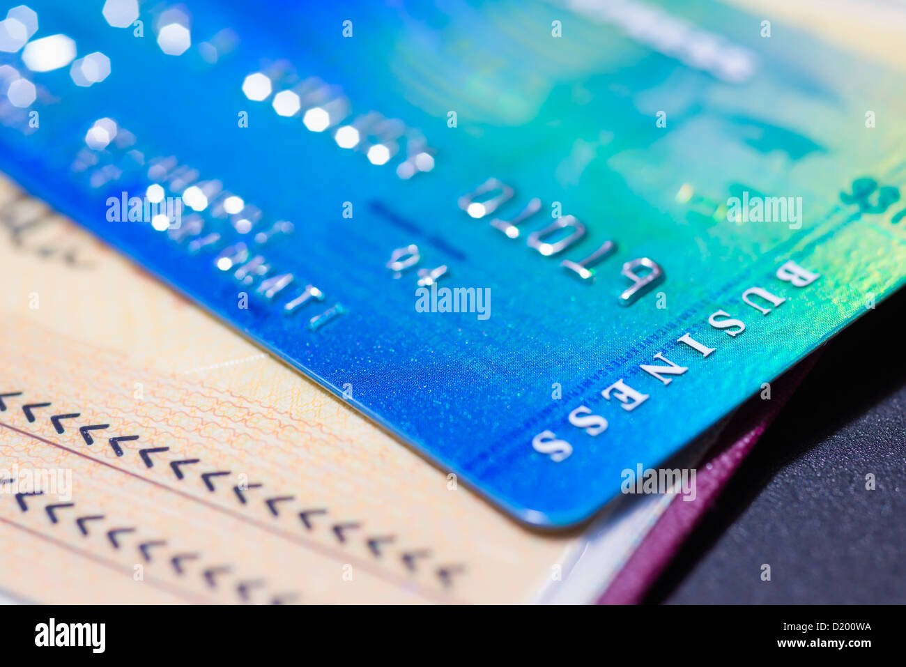 close up of american express business credit card on passport - American Express Business Credit Card