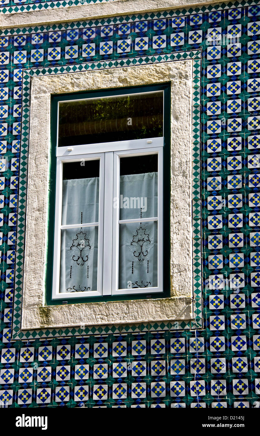 decorative azulejos ceramic tiles on facade of traditional house