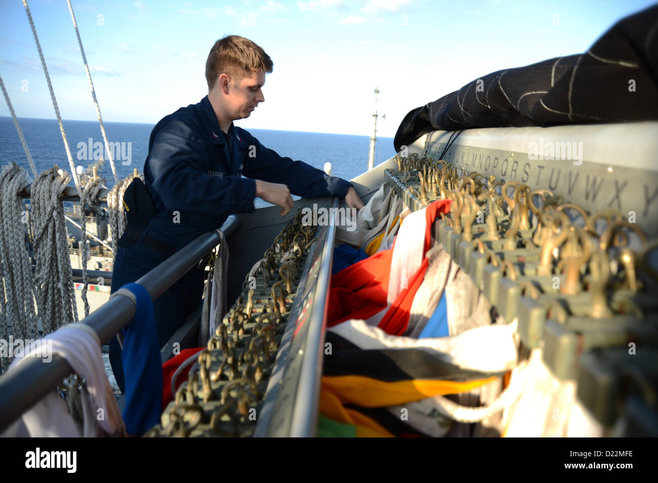 U.s. Navy Quartermaster 2nd Class Brad Barber Stores Flags Aboard ...
