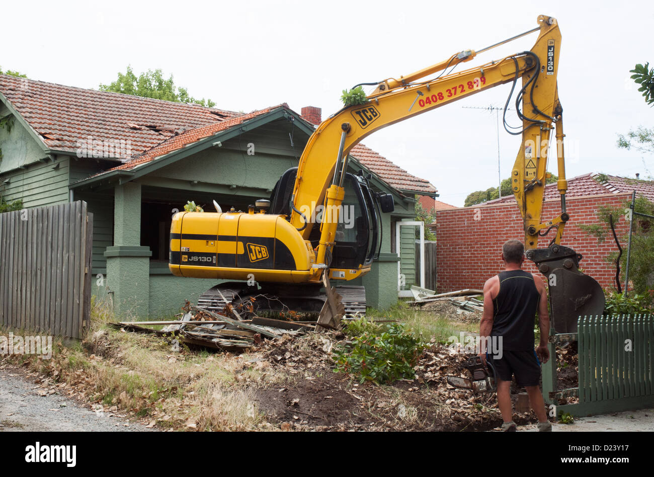 A Contractor Prepares To Begin Demolition Of 1920s Californian Bungalow Timber Home In Suburban Melbourne Australia