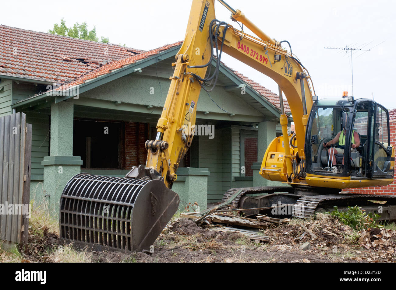 Demolition Contractor Begins Work On A 1920s Californian Bungalow Timber Home In Suburban Melbourne Australia