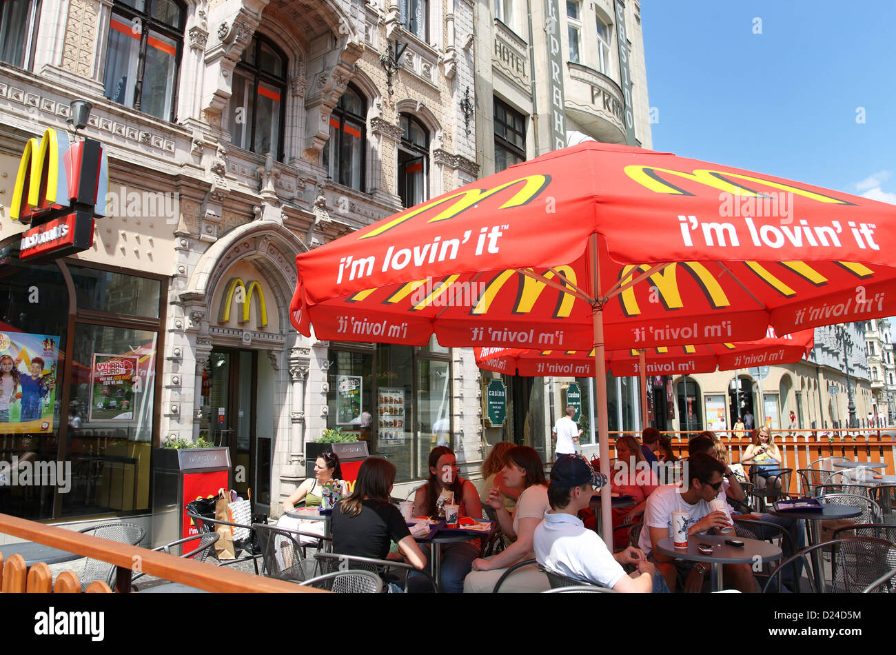 Liberec Czech Republic  city pictures gallery : Liberec, Czech Republic, People Sit In Front Of A Mcdonalds Stock ...