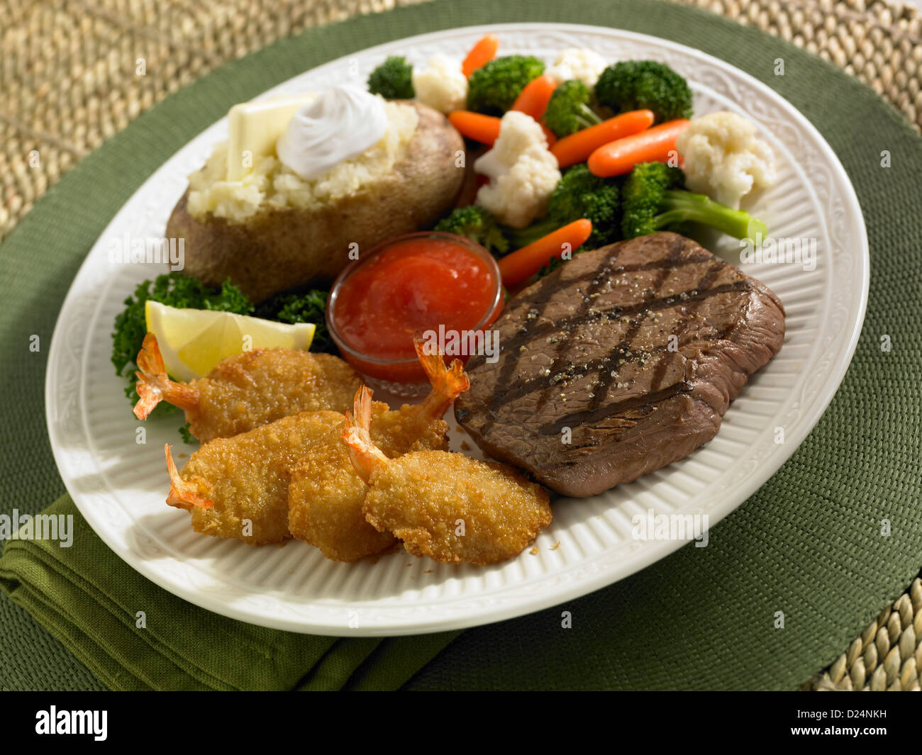 Steak And Fried Shrimp Dinner Served With Loaded Baked Potato And Vegetables