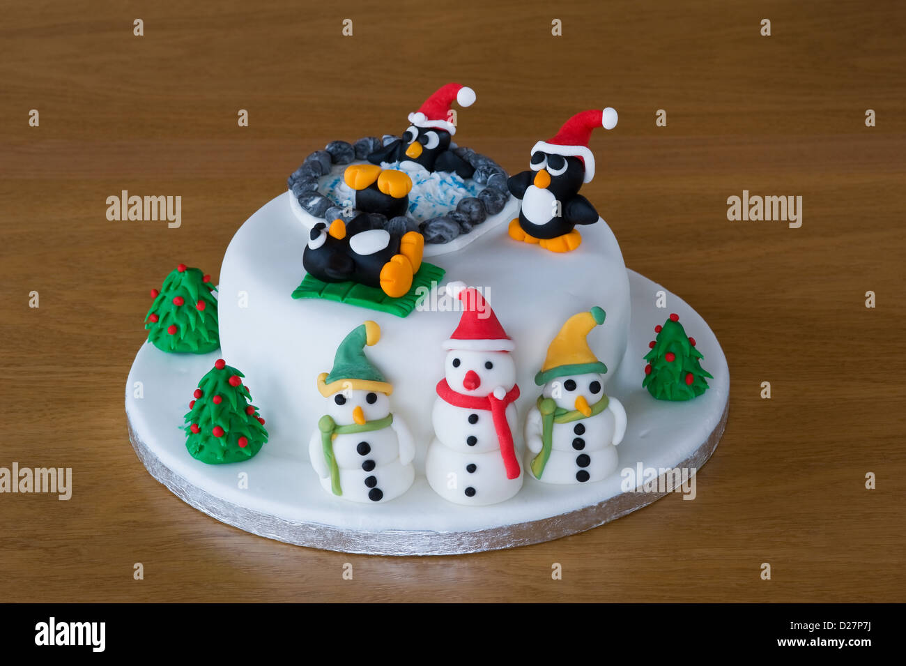 Novelty Christmas Cake Images : Novelty christmas cake, decorated with amusing penguins ...
