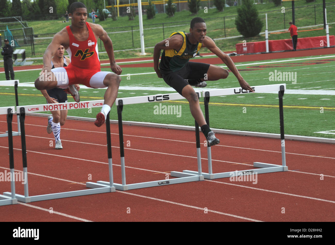 Teens Jump The Hurdles In A Track And Field Event In ...