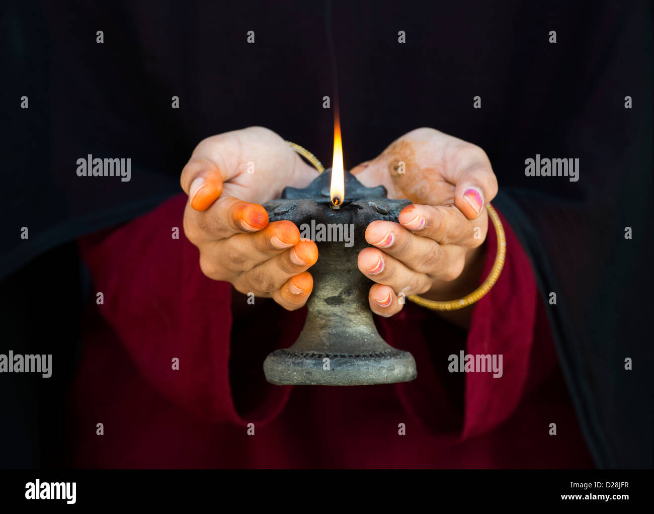 Teenage Indian girl holding a lit oil lamp Stock Photo, Royalty ... for Girl Holding Lamp  113lpg