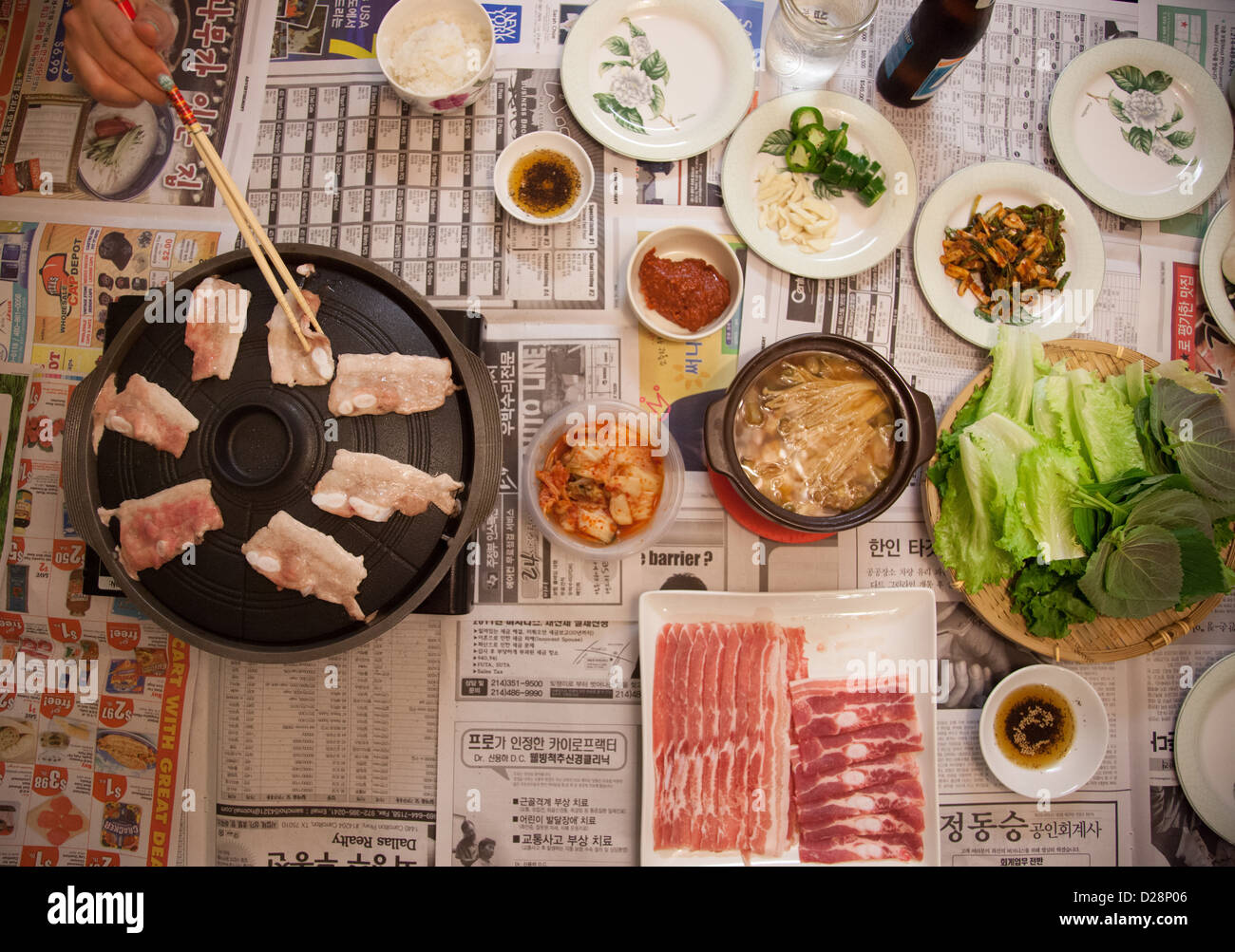 Home Cooked Korean Bbq Pork Belly Dinner On Top Of Newspaper