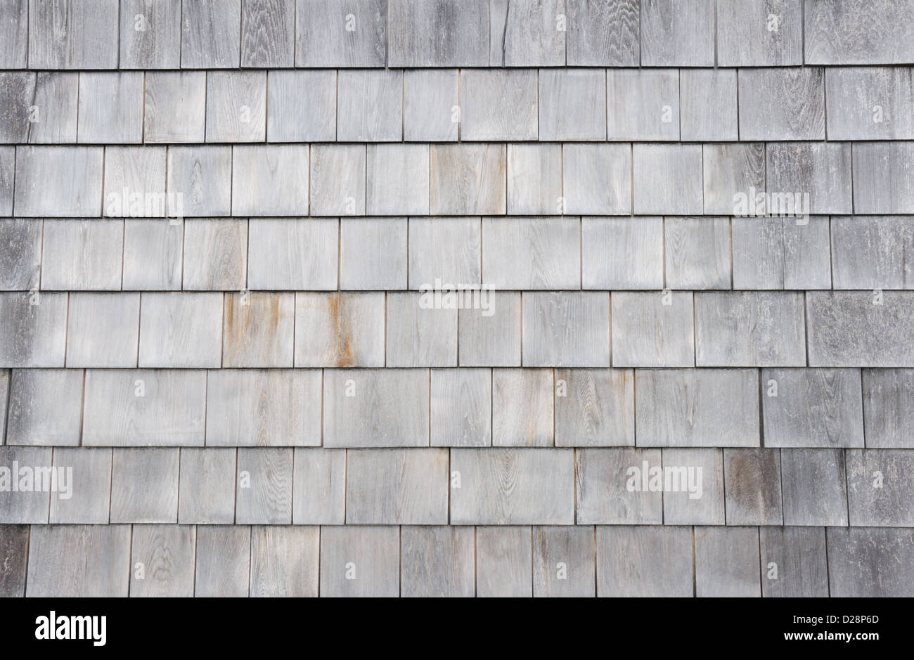 Clapboard shingles on a cape cod style house for Shingle art cape cod