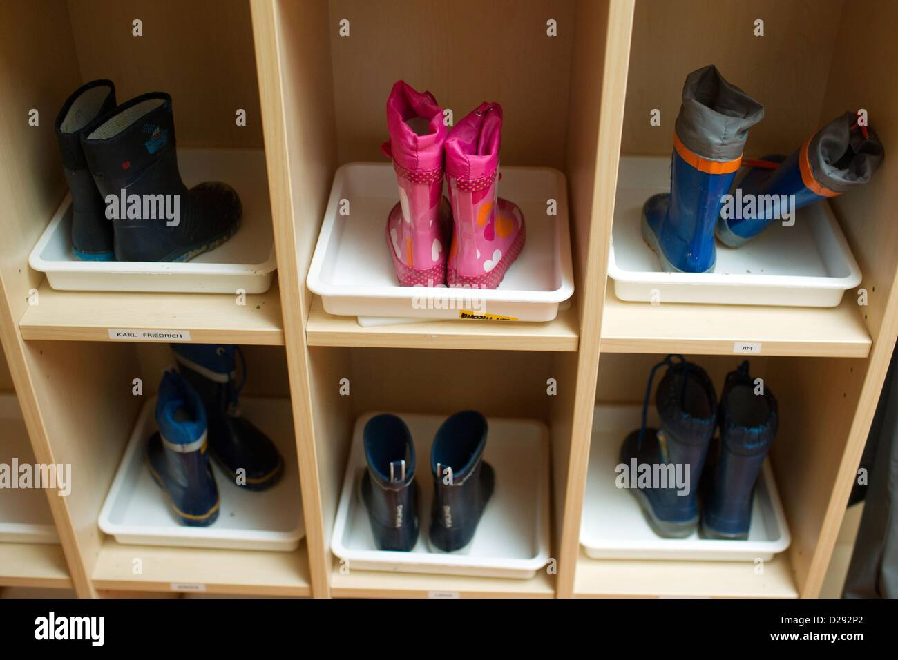 Children's rain boots stand in the shoe cabinet in the 24 hour ...