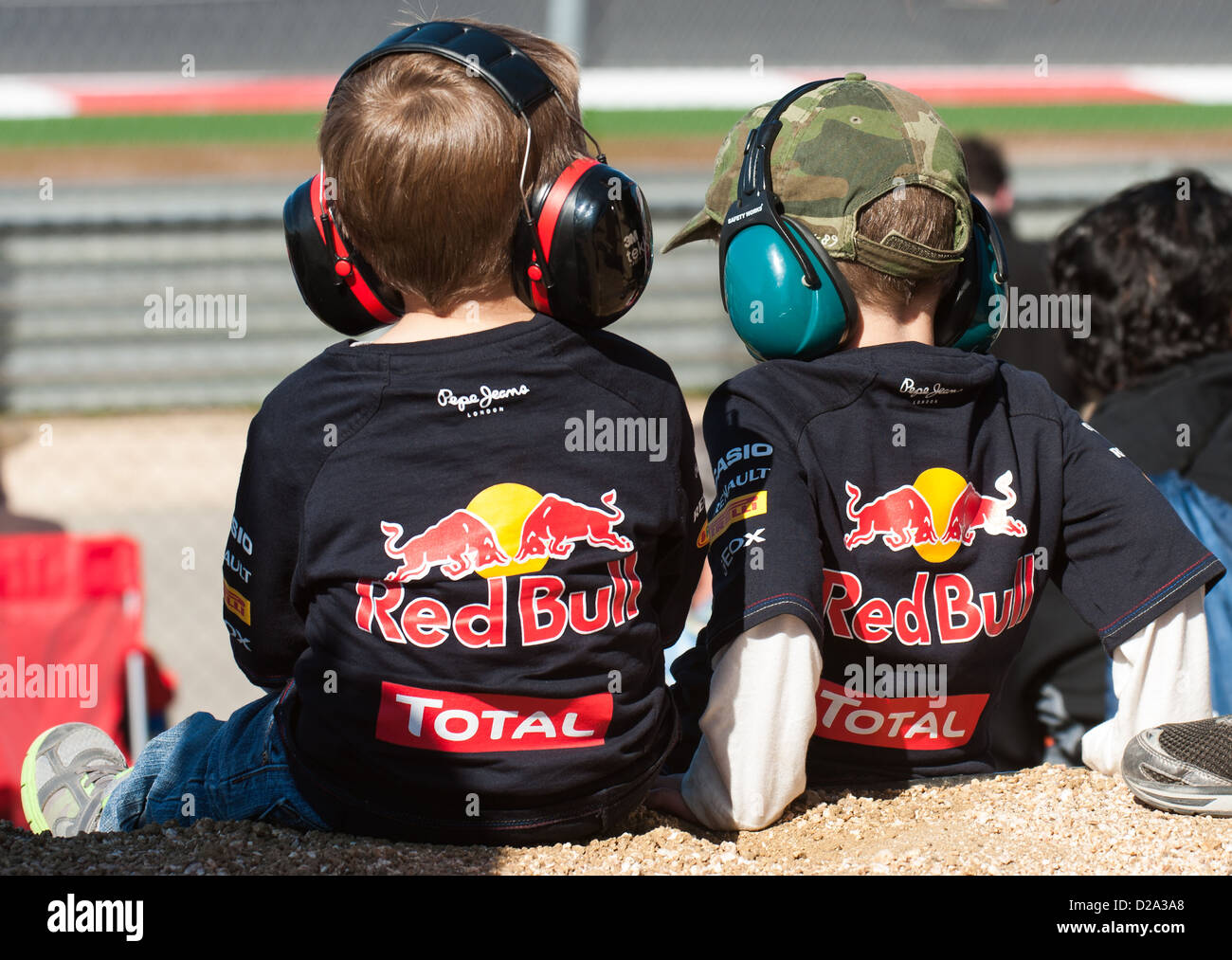 two young red bull racing fans watch the action during qualification stock photo royalty free. Black Bedroom Furniture Sets. Home Design Ideas