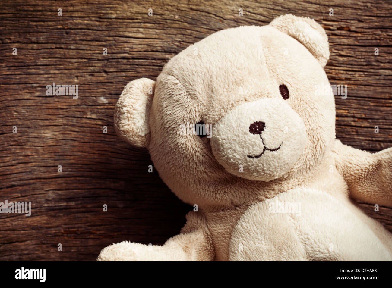 the teddy bear on old wooden background stock photo royalty free