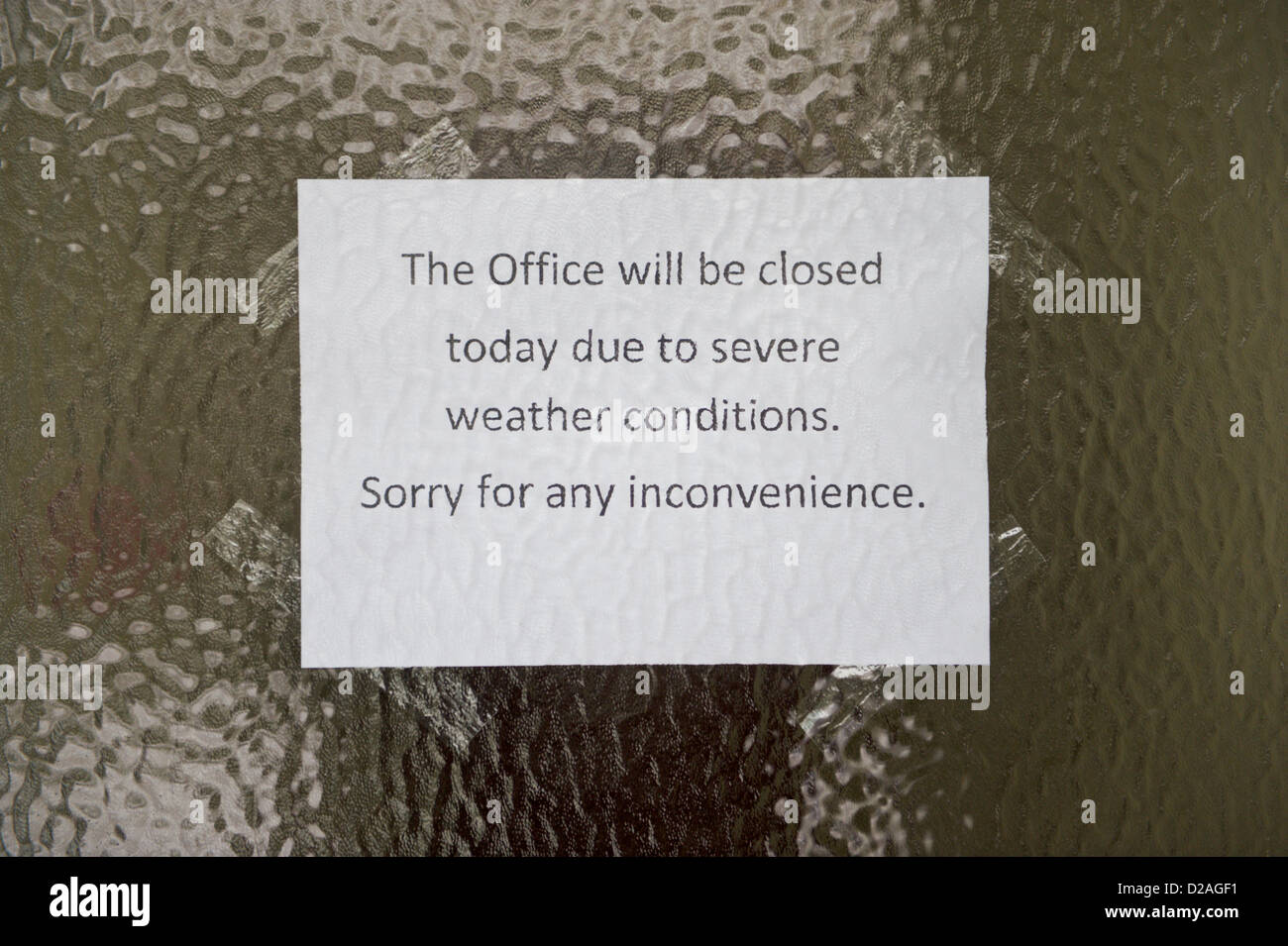 Sign on front door of office closed due to severe snow weather conditions. Hay-on-Wye Powys Wales UK. 18th January 2013. Credit Jeff Morgan/Alamy Live ... & Sign on front door of office closed due to severe snow weather ...