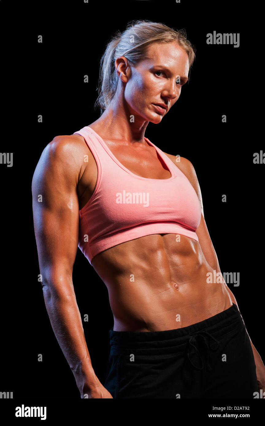 Female bodybuilder showing off muscles Stock Photo ...
