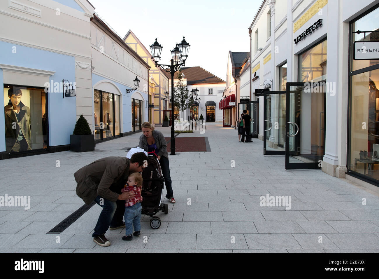 wustermark germany young family in b5 designer outlet center stock photo royalty free image. Black Bedroom Furniture Sets. Home Design Ideas