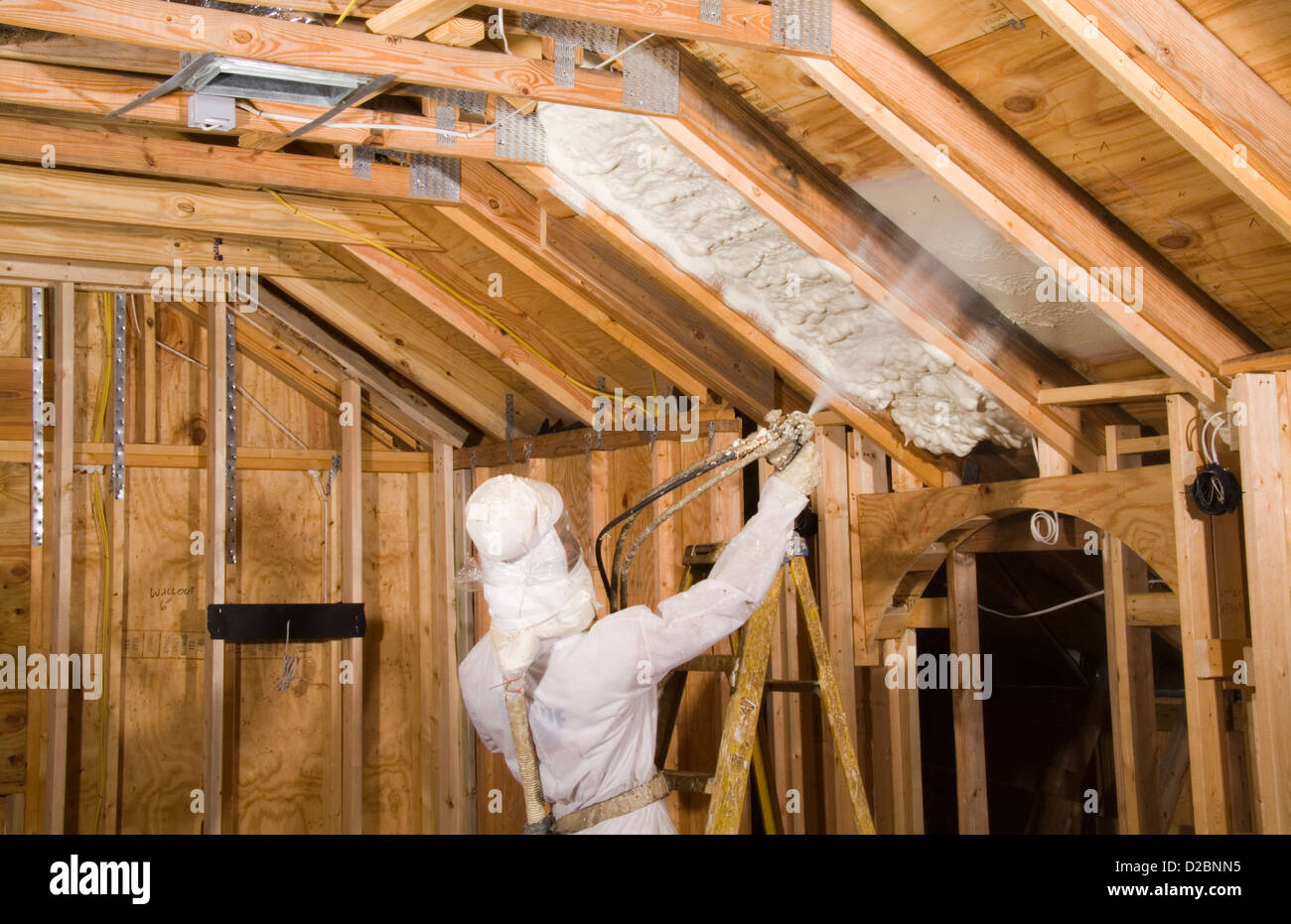 Saving energy in home by spraying insulation into ceiling for Insulate your home for free