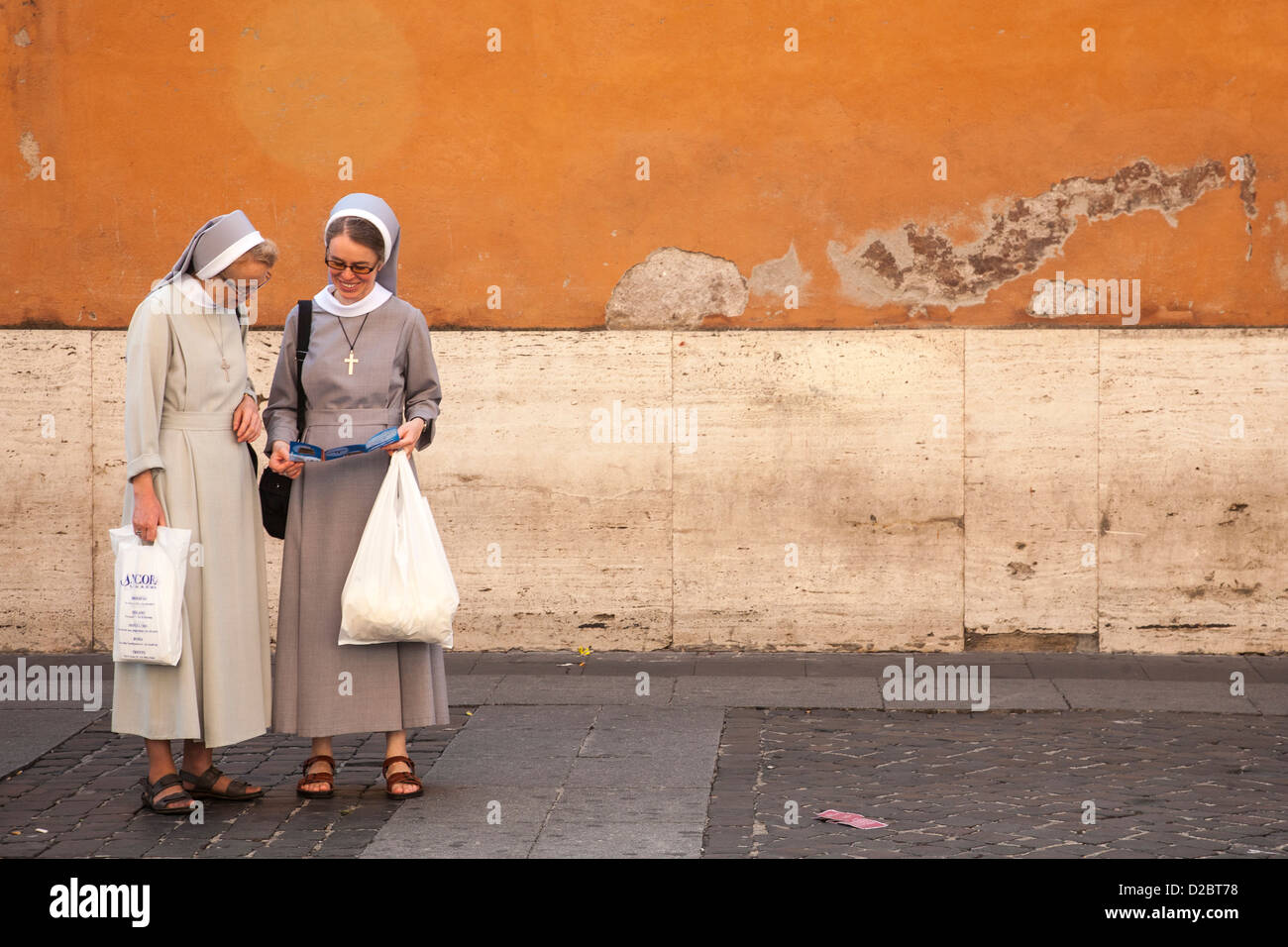 nuns looking at a map in the Vatican City Rome Italy Stock Photo
