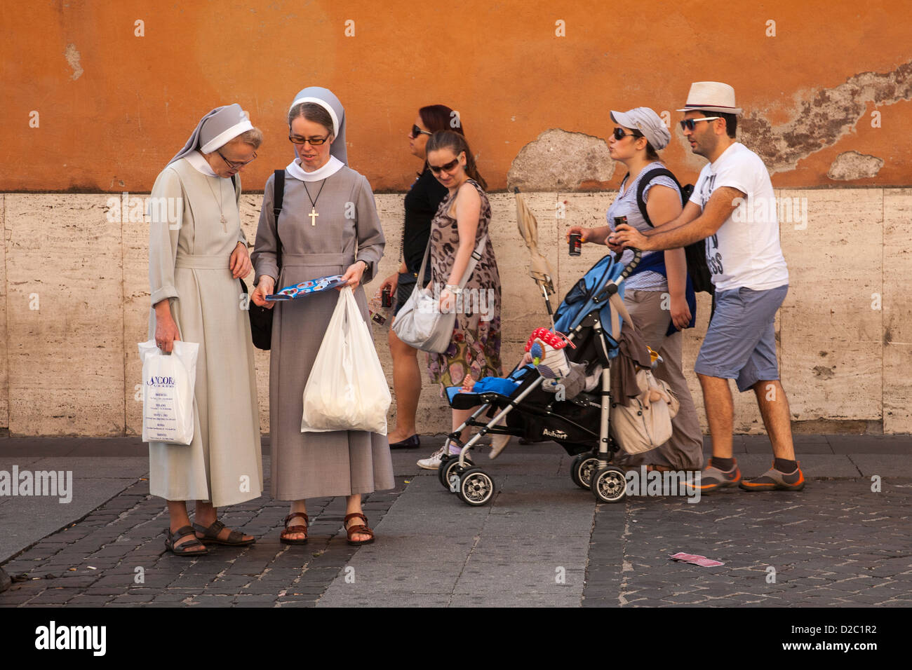 nuns looking at a map The Vatican City Rome Italy Stock Photo