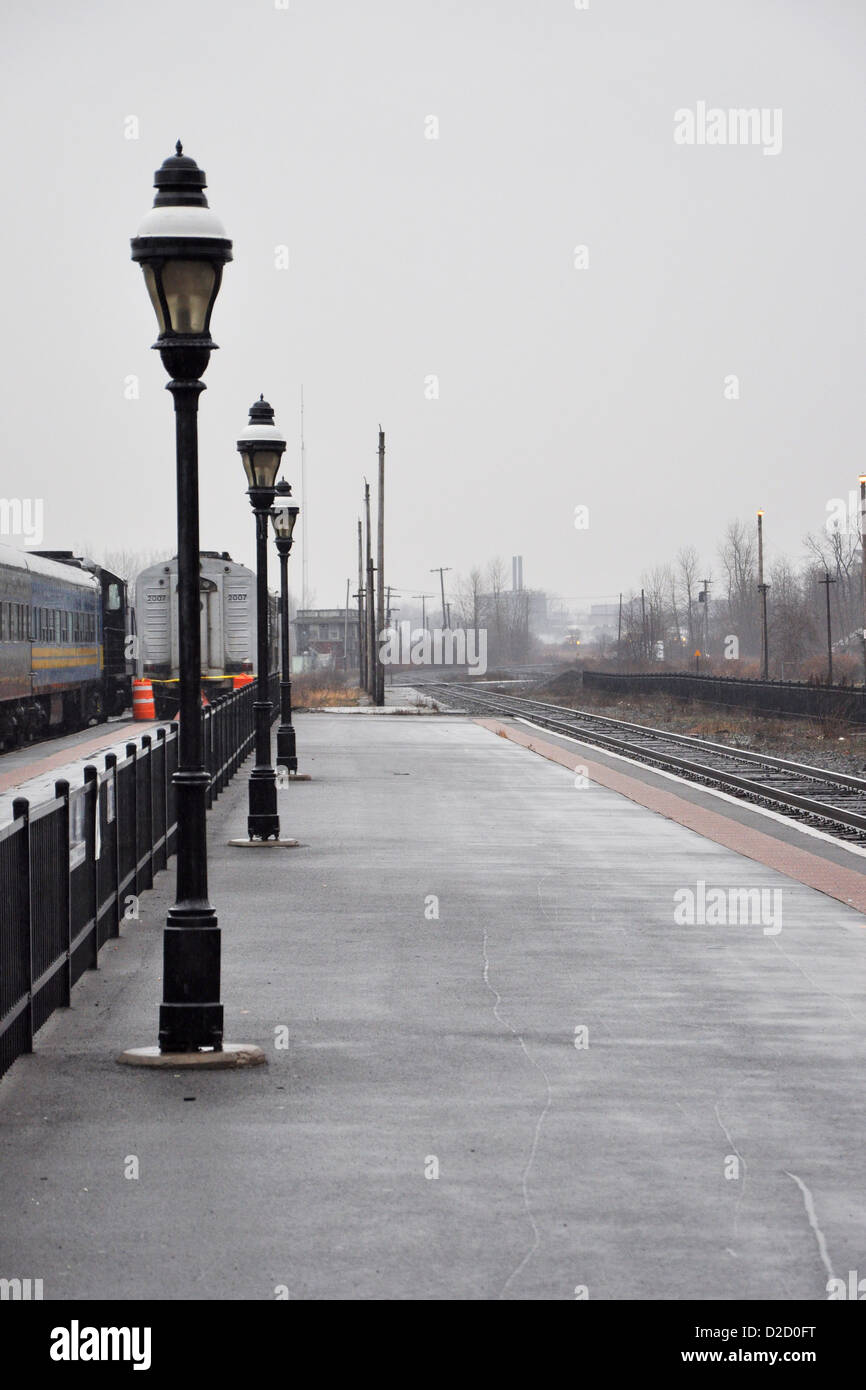 Empty train platform at a railroad station on a cloudy day stock empty train platform at a railroad station on a cloudy day arubaitofo Image collections