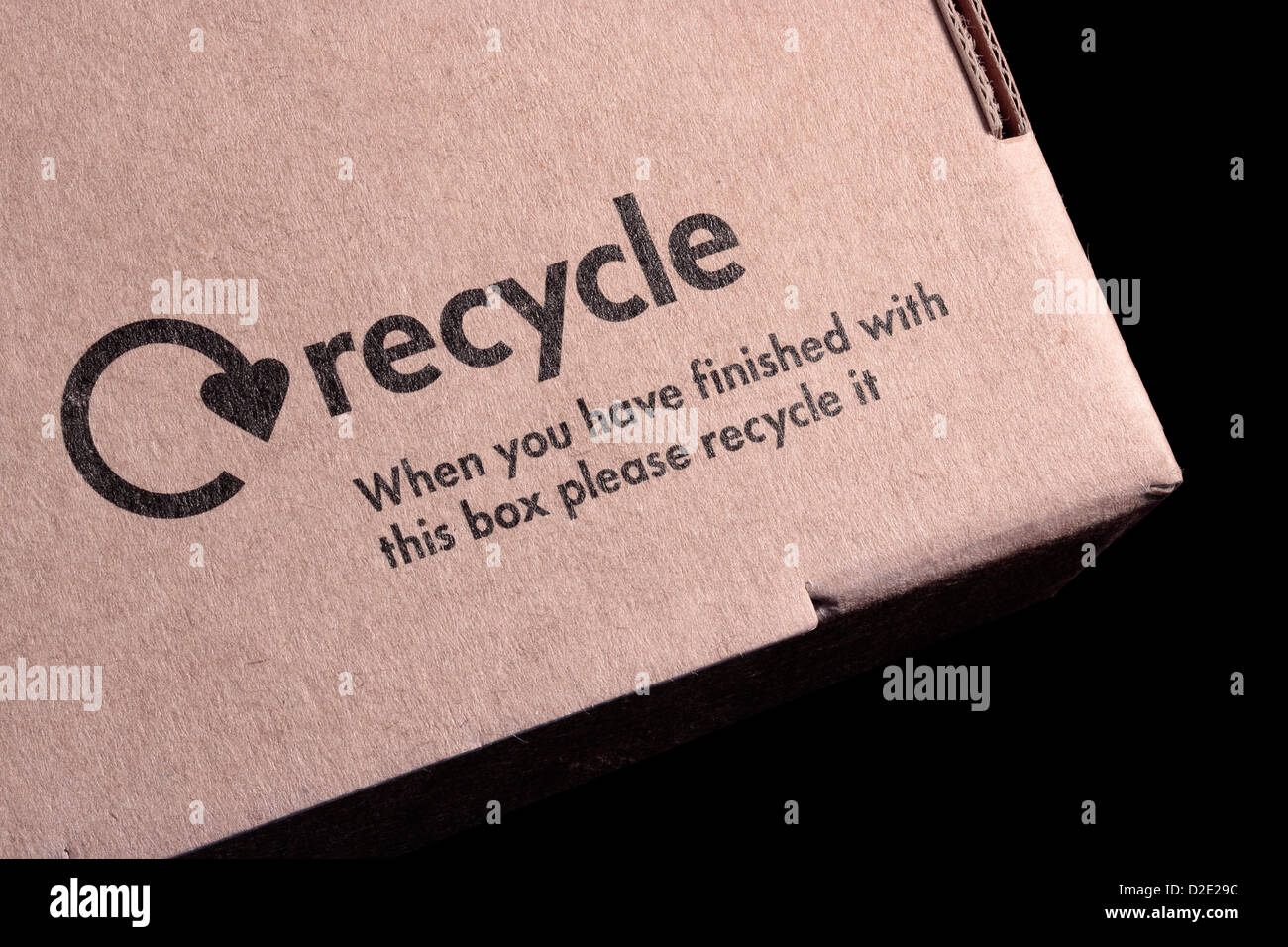 Cardboard box on black background stock photos cardboard box on cardboard box recycling symbol and message when you have finished with this box please recycle it buycottarizona Gallery
