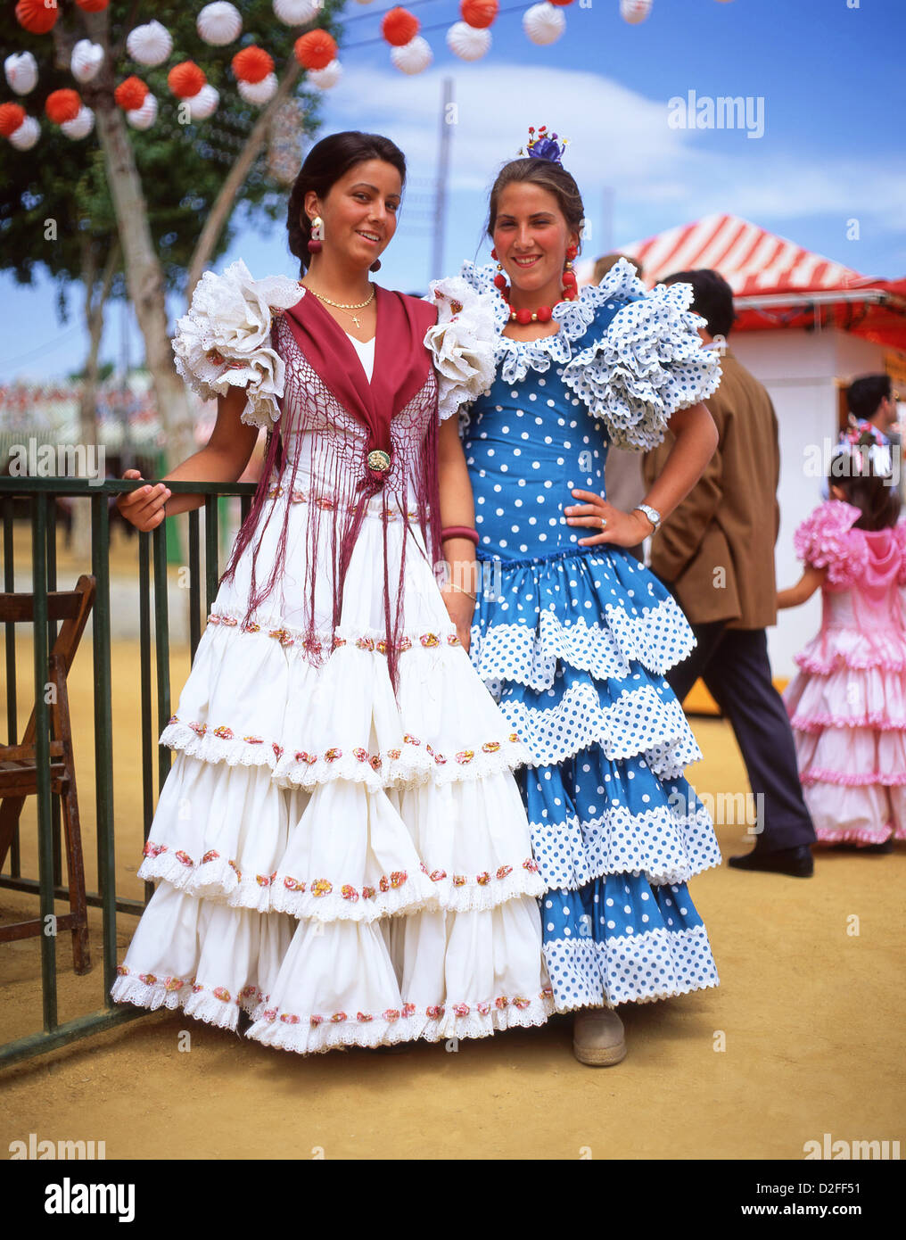 Young women in flamenco dresses at feria de abril de for Espectaculo flamenco seville sevilla