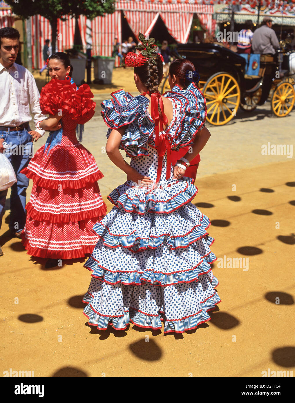 Young girls in flamenco dresses at feria de abril de for Espectaculo flamenco seville sevilla