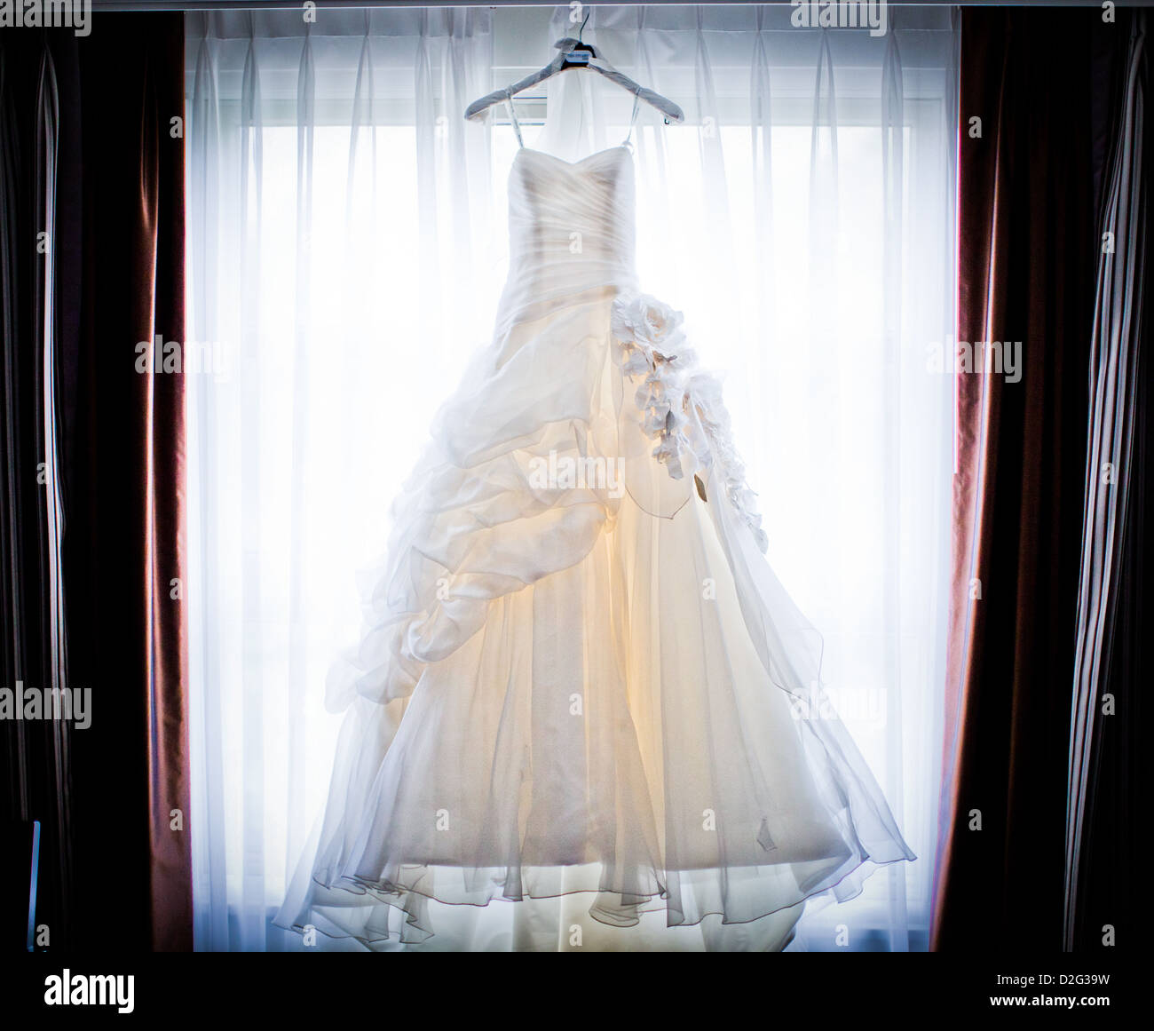 Photo Of A Beautiful White Wedding Dress Hanging Up In Window