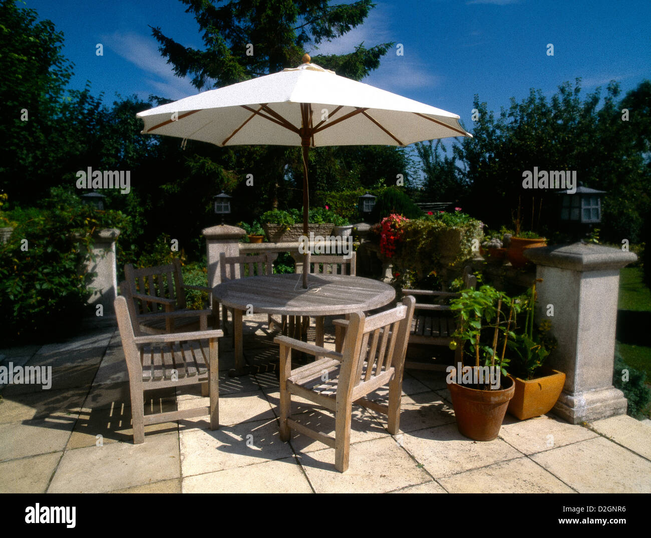 stock photo wooden garden furniture table chairs sun shade umbrella