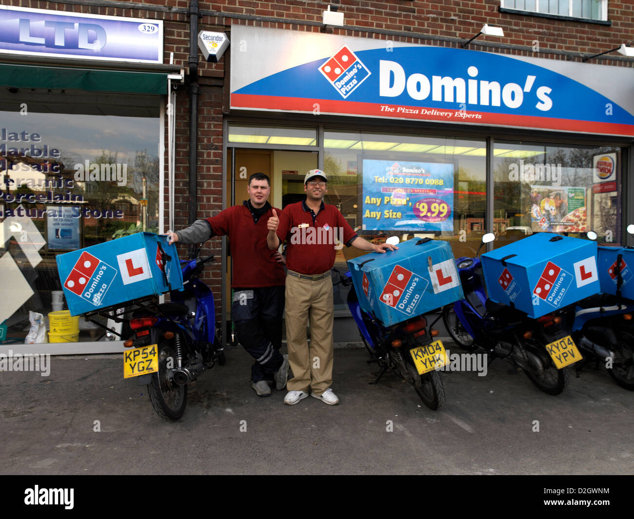 delivery rider outside dominos pizza in sutton surrey england stock photo royalty free image. Black Bedroom Furniture Sets. Home Design Ideas