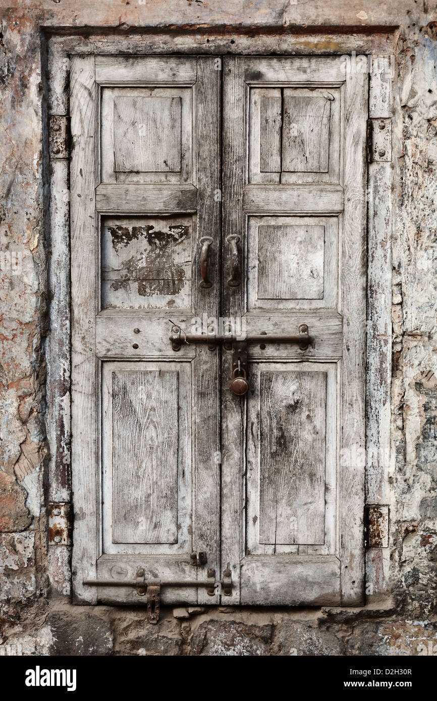 Rusty Door old wooden door with old rusty locks stock photo, royalty free