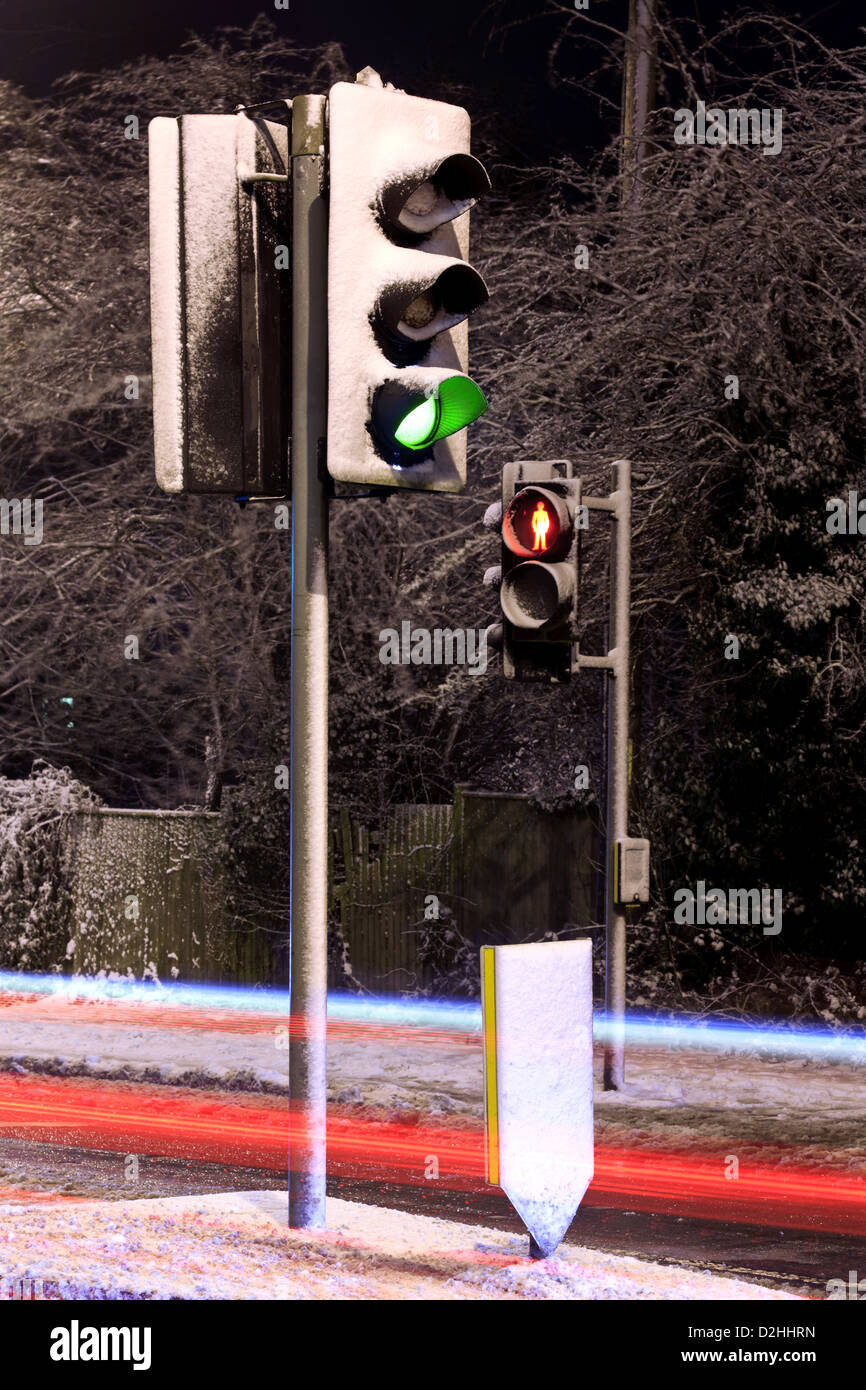 Traffic lights covered in snow on a UK road at night with light ... for Traffic Light On Road At Night  288gtk