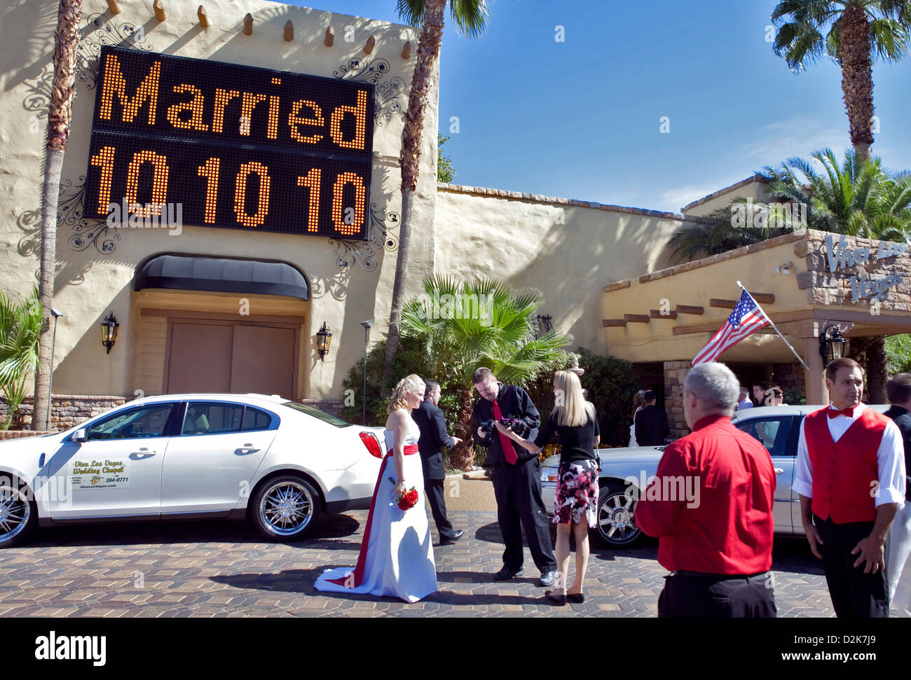 A RECENTLY MARRIED COUPLE OUTSIDE VIVA LAS VEGAS WEDDING CHAPEL IN DOWNTOWN OCTOBER 2010