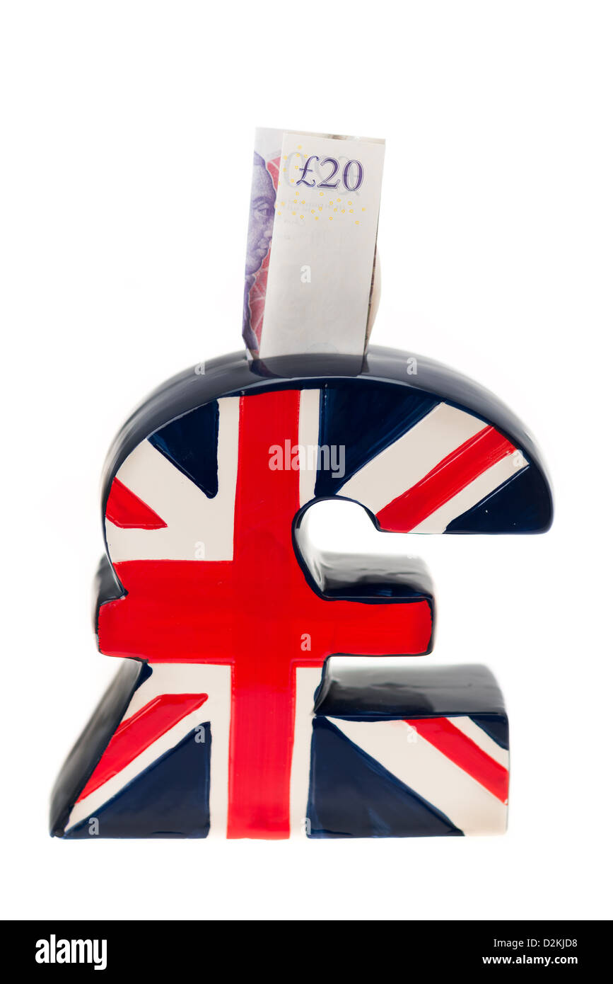 A piggy bank in the shape of a uk pound currency symbol emblazoned a piggy bank in the shape of a uk pound currency symbol emblazoned with the uk flag union jack being stuffed with money buycottarizona Choice Image