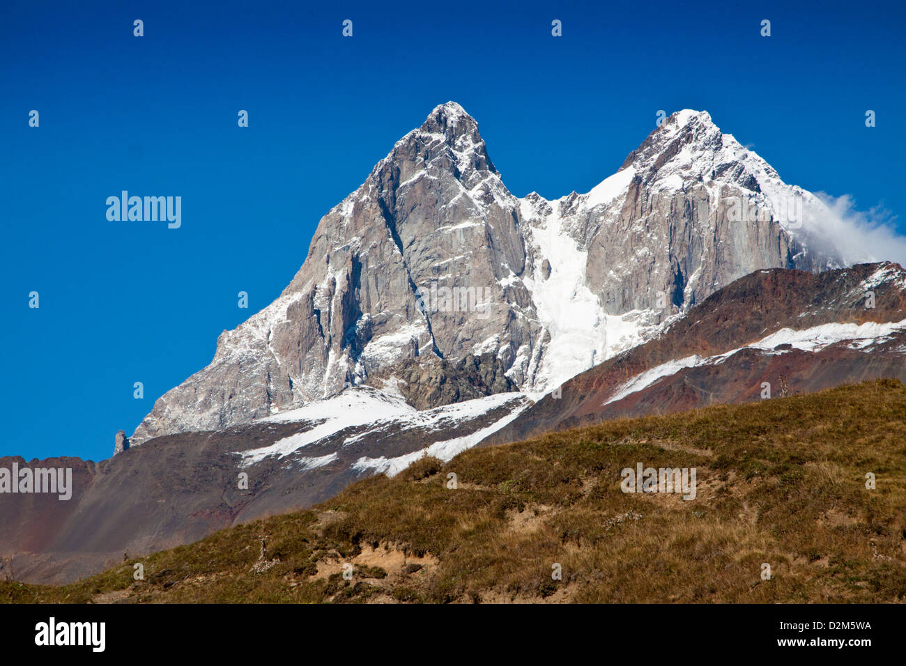 Twin peaks of Mount Ushba in Georgia's Svaneti region ...