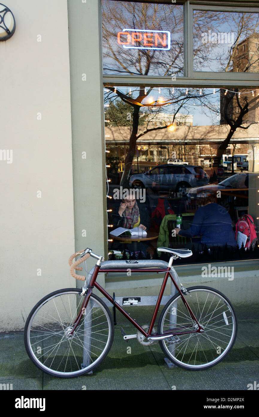 bicycle-parked-outside-a-coffee-shop-in-