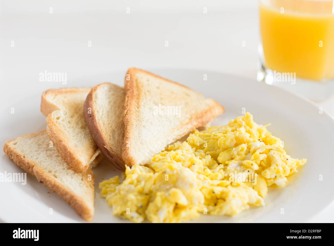 scrambled eggs, toast, orange juice Stock Photo, Royalty ...