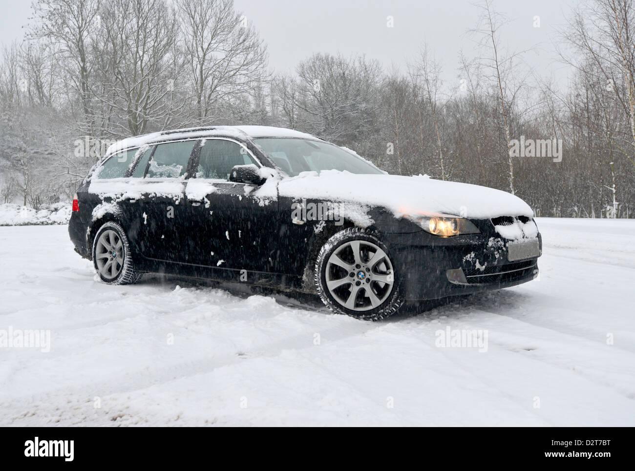 Bmw 520d 5 series rear wheel drive car in heavy snow the e61 estate car