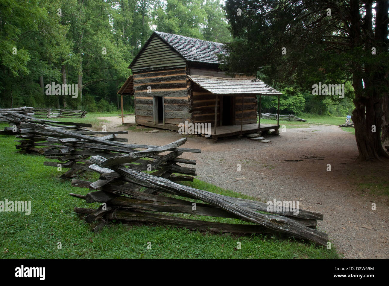Old rustic log cabin in the woods with a split rail fence for Old rustic cabins
