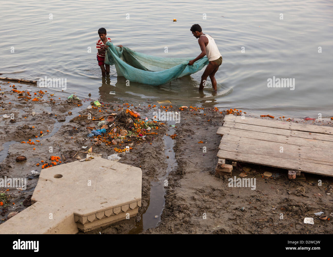 Father and son fishing in the ganges river varanasi for Az game and fish boat registration