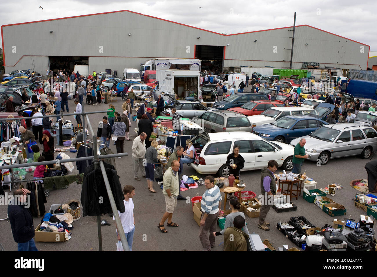Buyers and sellers at the splott car boot sale on lewis road cardiff