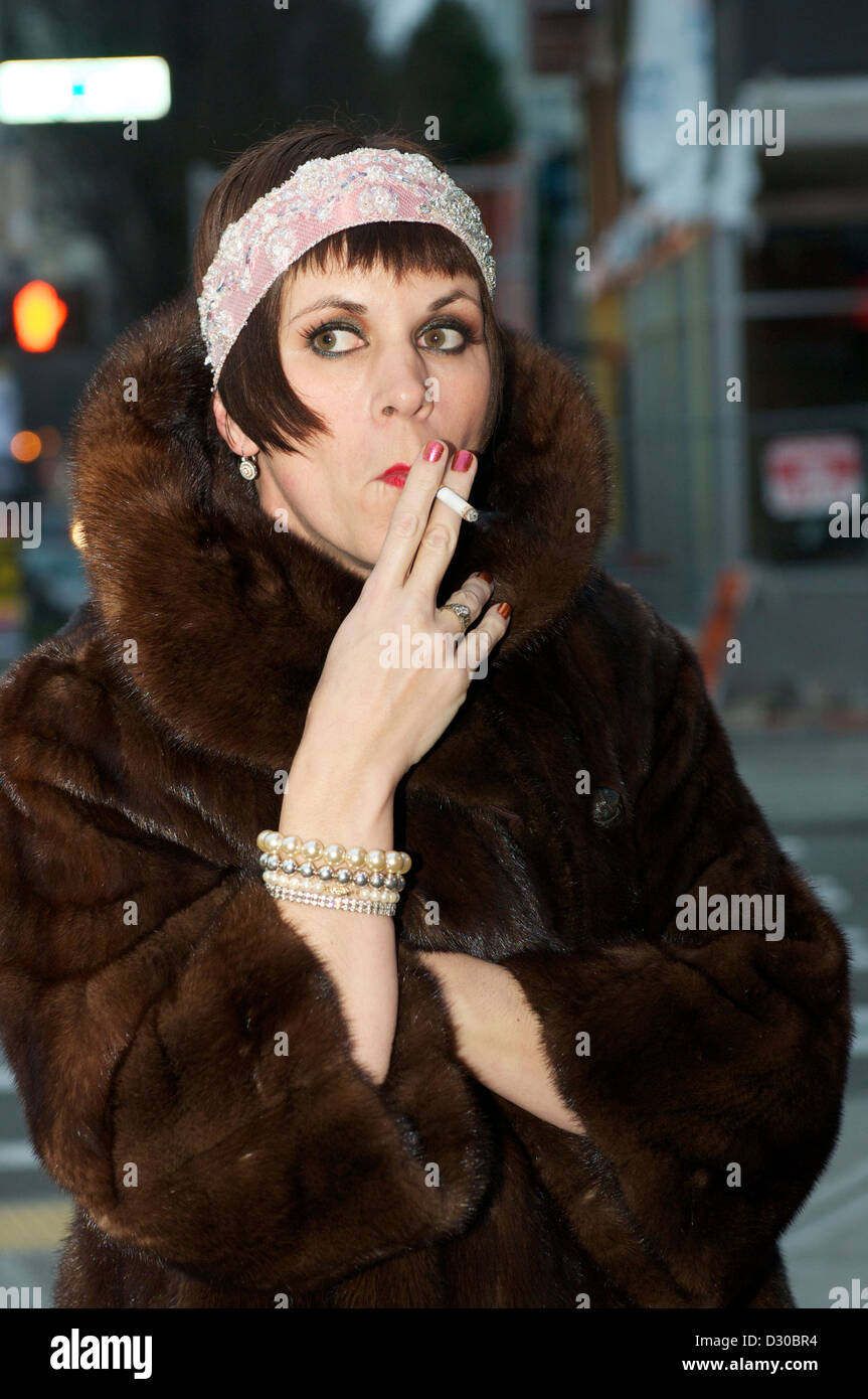Retro Chic Woman Smoking On A City Street In A Fur Coat